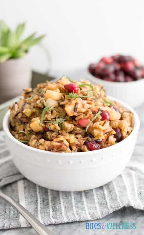 Wild Rice Stuffing is the perfect addition to your dinner or weeknight meal. It's super simple and full of fall flavors! It's #glutenfree #vegetarian! | https://bitesofwellness.com