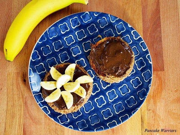 chocolate peanut butter with spread over an english muffin