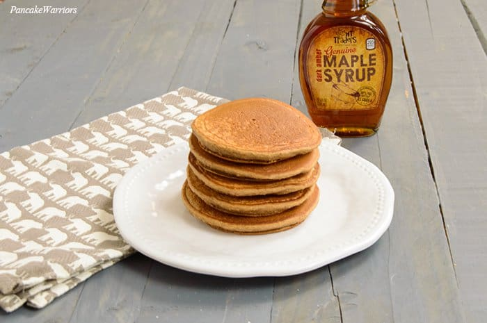 Spiced Apple Oat Protein Pancakes stacked on a plate