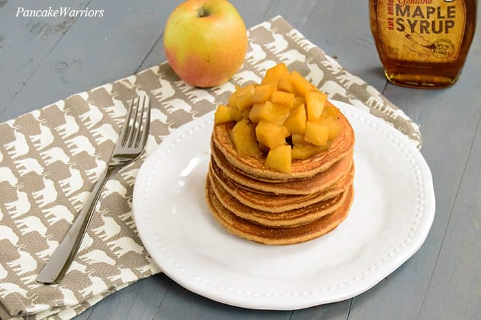 Spiced Apple Oat Protein Pancakes with apples on top