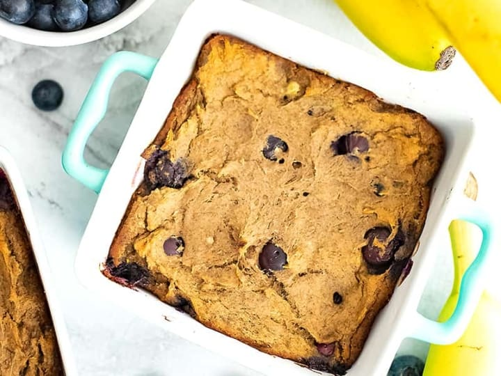 Blueberry Banana Bread in a square teal baking dish
