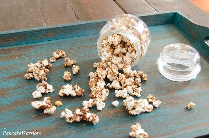Chocolate Popcorn spilling out onto a plate