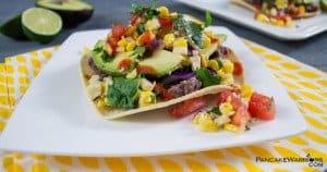 easy bean tostadas piled high with veggies on a plate