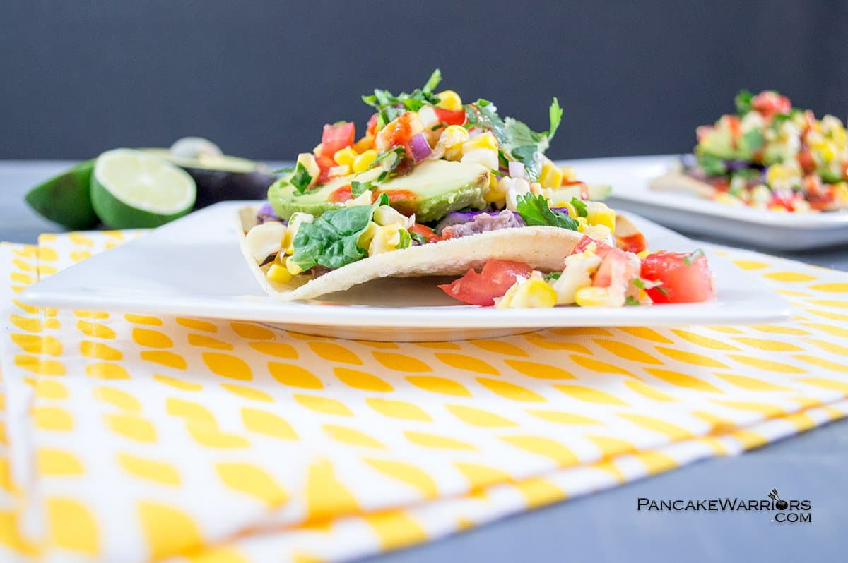 easy bean tostadas piled high wwith veggies on a plate