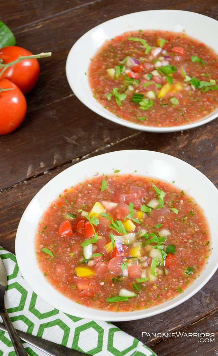 low fat watermelon gazpacho packed with veggies in a soup bowl