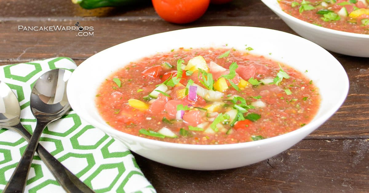 This easy watermelon gazpacho is a perfect summer soup! Packed with veggies and fruit, this low fat, gluten free, vegan recipe is sure to please a crowd. | www.PancakeWarriors.com
