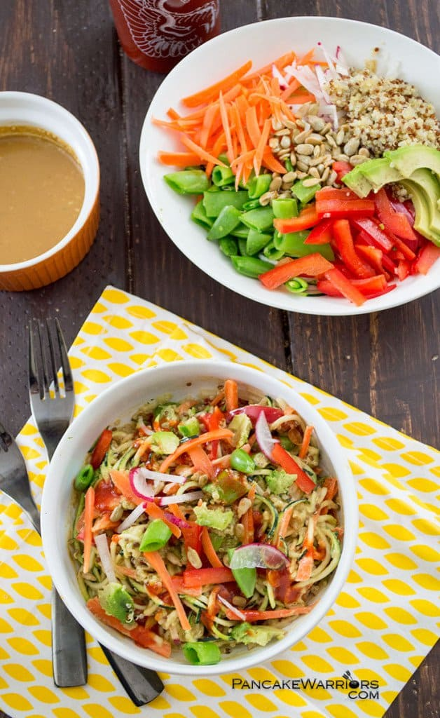 Asian Zoodle Buddha Bowl with avocado carrots quinoa and bell peppers mixed up
