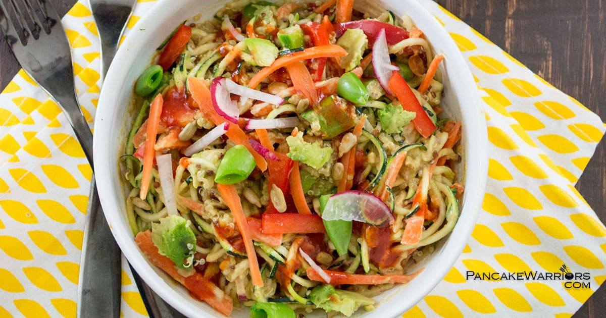 This Asian Zoodle Buddah Bowl is packed with fresh veggies and topped with a vegan peanut sauce. Low fat, gluten free and ready in 10 minutes. An easy weeknight dish that doesn't require any cooking and kids will gobble up! | www.pancakewarriors.com