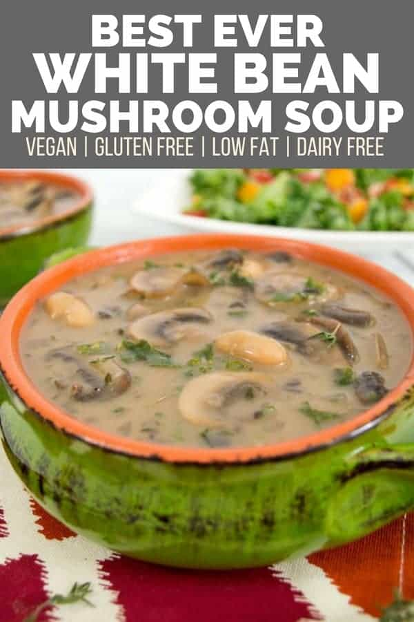 best ever white bean mushroom soup in a green and orange soup bowl filled with mushrooms