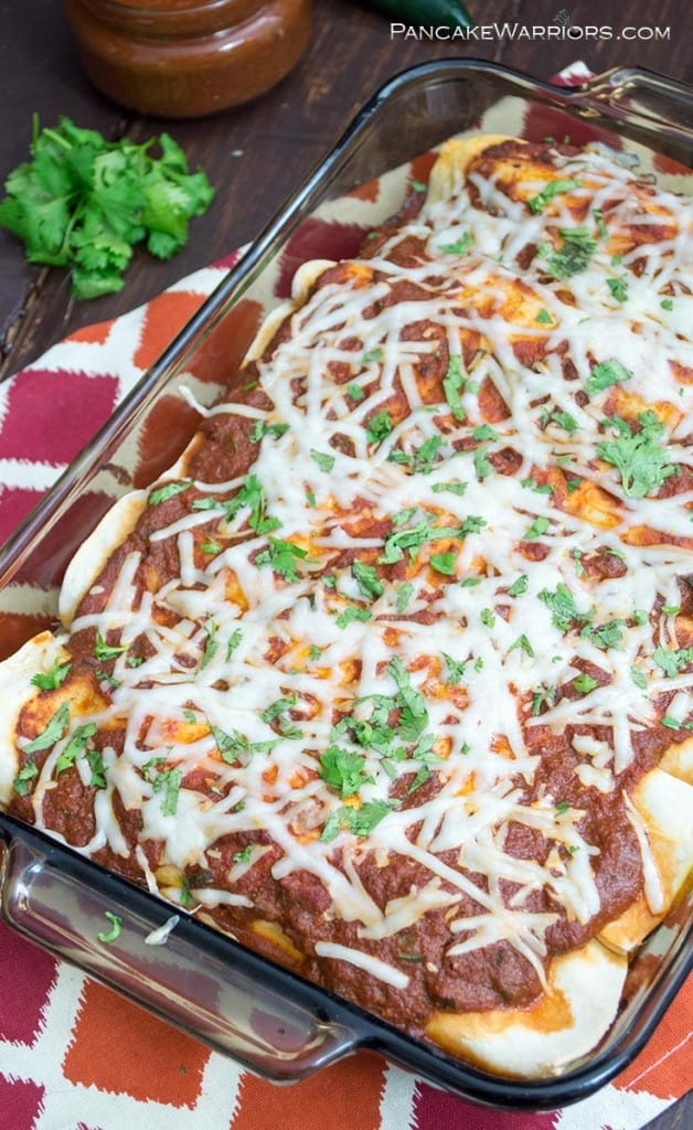 pumpkin black bean enchilada topped with cheese and sauce
