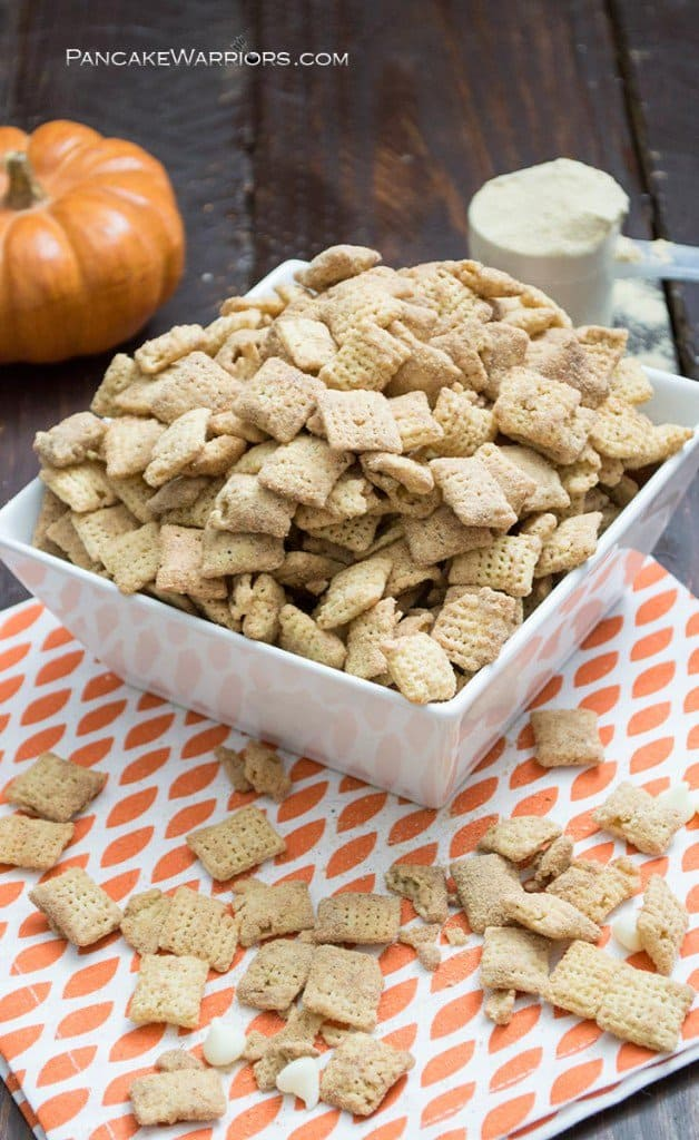 Pumpkin spice protein puppy chow in a big bowl spilling out the sides
