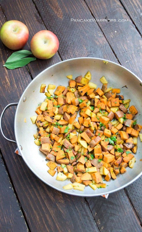 This quick apple sweet potato hash is the perfect side dish. Great for breakfast, lunch, brunch or dinner! Quick, simple vegan, gluten free, low fat and full of flavor! | www.pancakewarriors.com