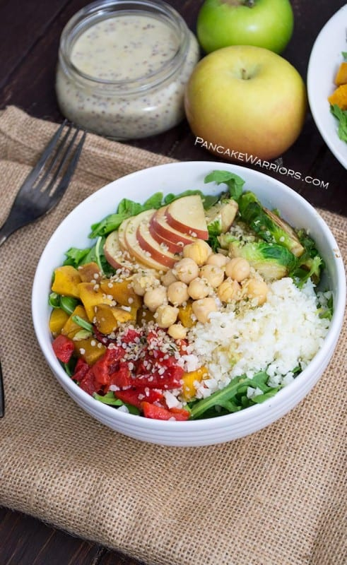 Hearty and filling, this fall Buddha Bowl with Maple Tahini Dressing is a simple vegan, gluten free meal idea. Ready in just minutes, this Buddha bowl is perfect for lunch or dinner! | www.pancakewarriors.com