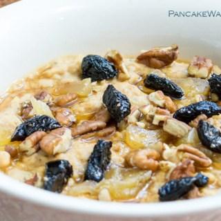protein pumpkin oatmeal in a bowl with raisins