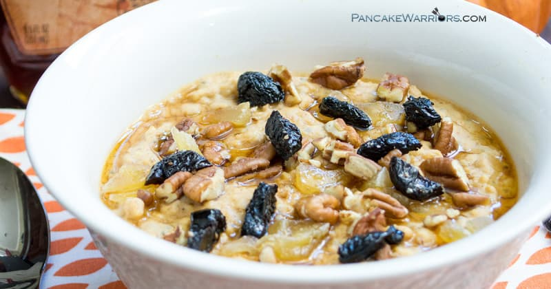 protein pumpkin oatmeal in a bowl with raisins