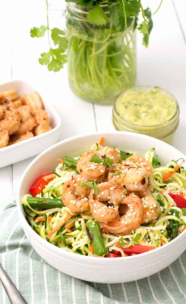 ginger garlic shrimp zoodle bowl packed with shrimp and zoodles