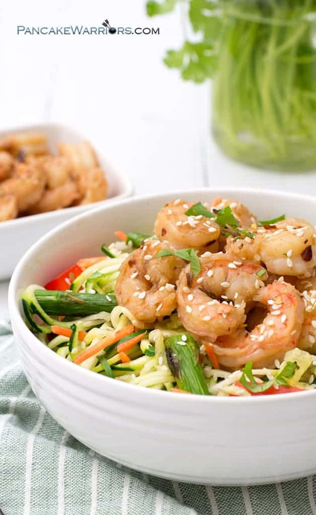 ginger garlic shrimp zoodle bowl packed with shrimp for protein