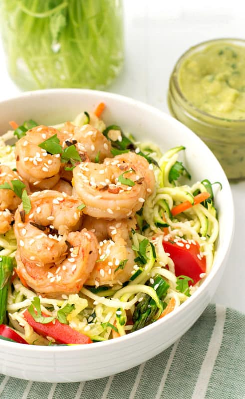 Fresh, healthy dinner in under 10 minutes with this ginger garlic shrimp zoodle bowl. Gluten free, low carb, paleo, whole30, and grain free dinner idea!