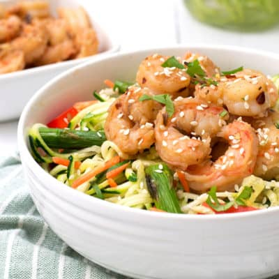 Fresh, healthy dinner in under 10 minutes with this garlic ginger shrimp zoodle bowl. Gluten free, low carb, paleo, whole30, and grain free dinner idea!