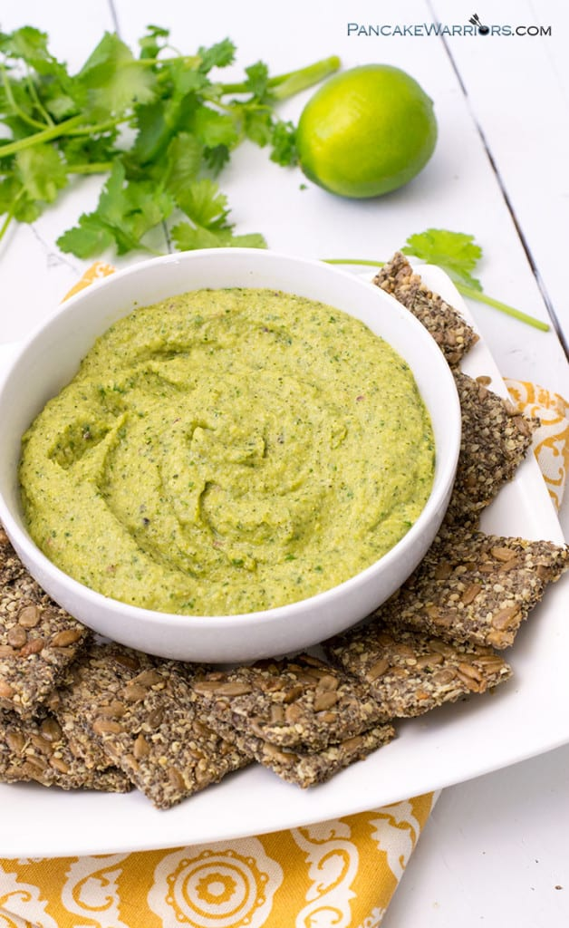 paleo avocado zucchini hummus in a bowl with crackers
