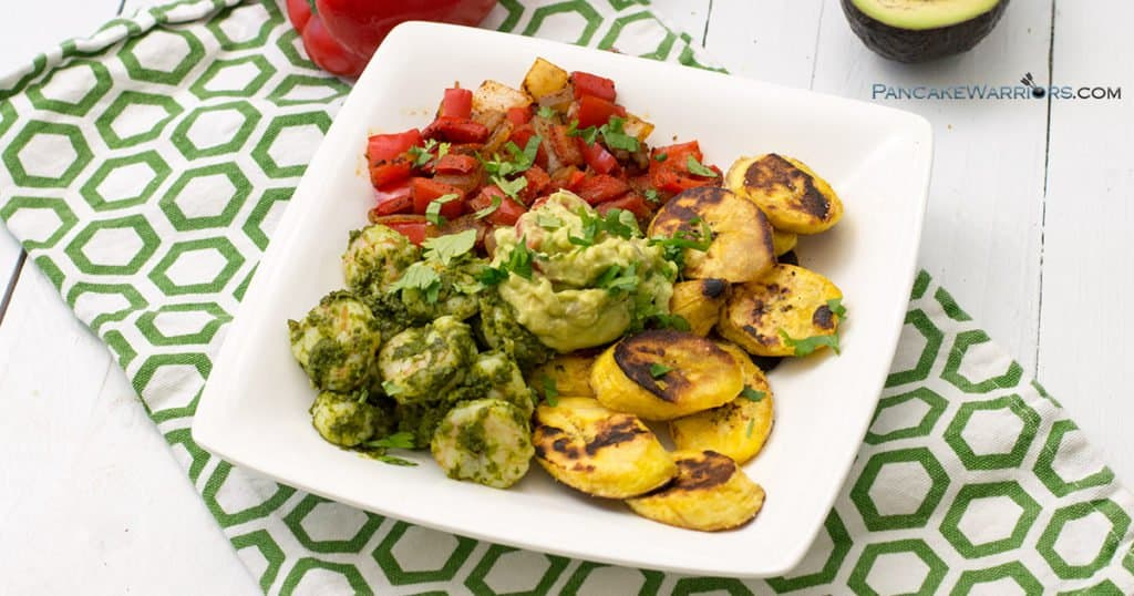 healthy chimichurri shrimp with plantains and smokey veggies on a plate