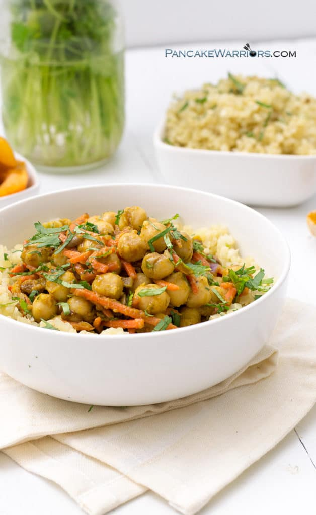 apricot chickpea curry piled high in a bowl with cauliflower rice