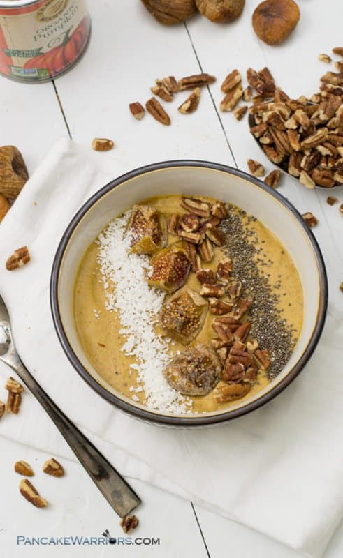 This creamy pecan pumpkin pie smoothie bowl is perfect for breakfast or as a snack! Gluten free, grain free, vegan, paleo and kid friendly, this recipe is ready in under 5 minutes and packed with nutrition! | www.pancakewarriors.com