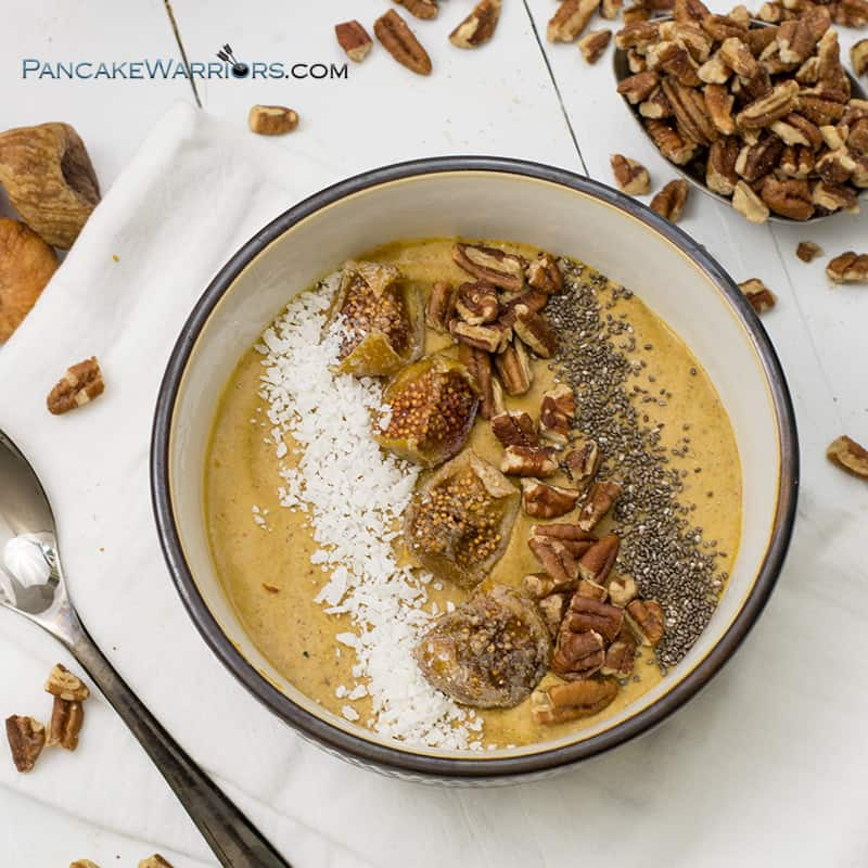 pecan pumpkin pie smoothie bowl with chia seeds, figs and coconut flakes