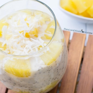 pina colada chia pudding with pineapple chunks and coconut flakes
