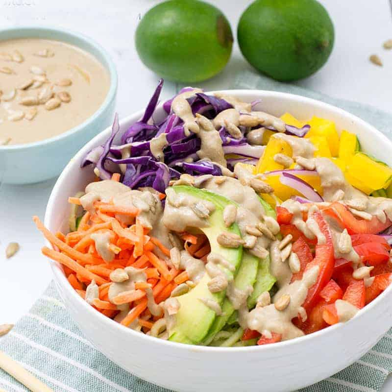 vegan pad thai with carrots, bell peppers, avocado and red cabbage with peanut sauce