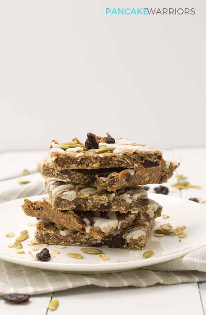 cinnamon raisin oatmeal protein bars piled high on a plate