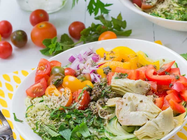 Greek Zoodle Bowl with bell peppers, artichoke hearts and tomatoes