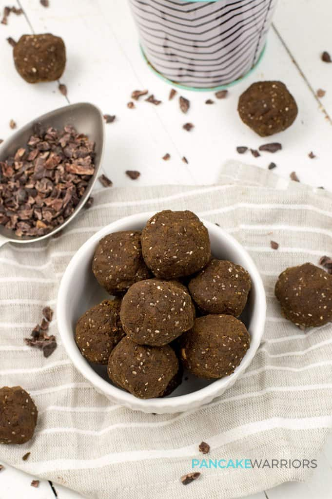 hemp protein brownie bites in a bowl with cocoa nibs