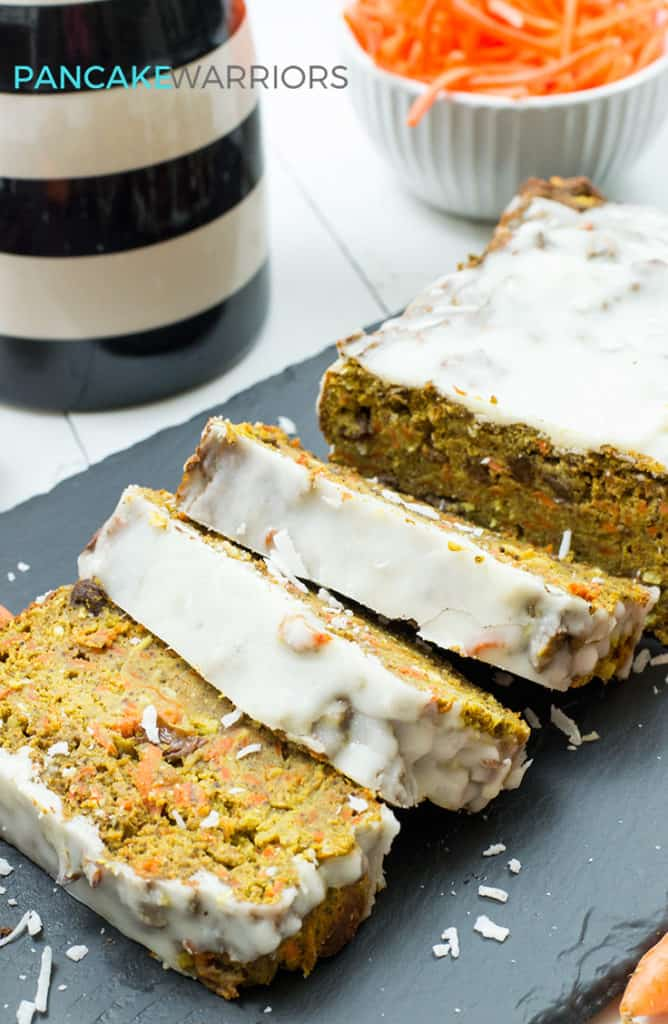 carrot cake banana bread with coconut butter frosting cut into slices