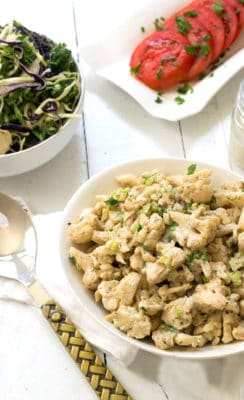 Creamy, tangy Whole30 cauliflower potato salad is the perfect side dish. Paleo, vegan and so simple! Made with an addiciting tahini dressing! | www.bitesofwellness.com
