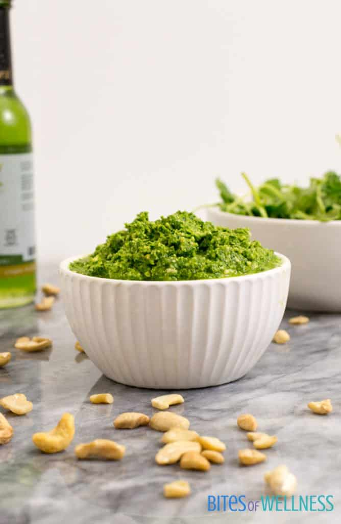 creamy arugula cashew vegan pesto piled high in a bowl