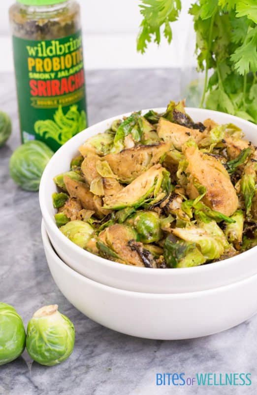 These super simple whole30 spicy sriracha brussels sprouts are the most flavorful side dish! Paleo, vegan and ready in under 10 minutes! | bitesofwellness.com