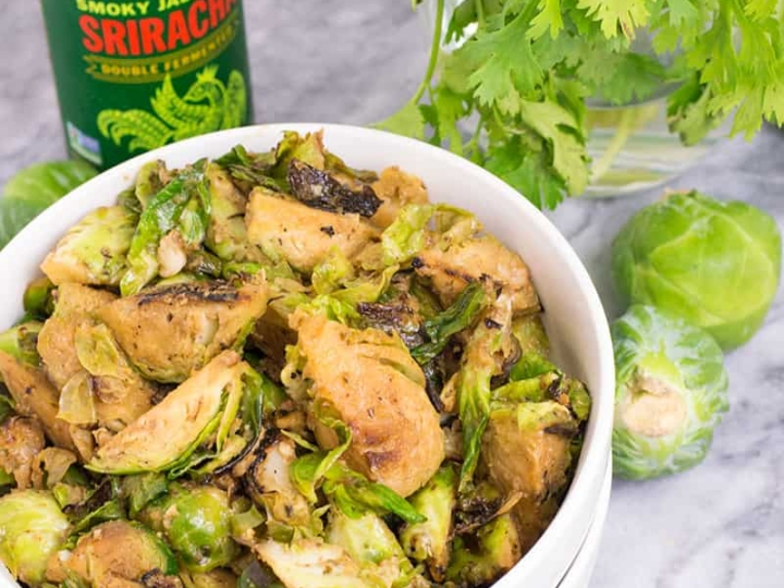 a bowl of whole30 spicy sriracha brussels sprouts