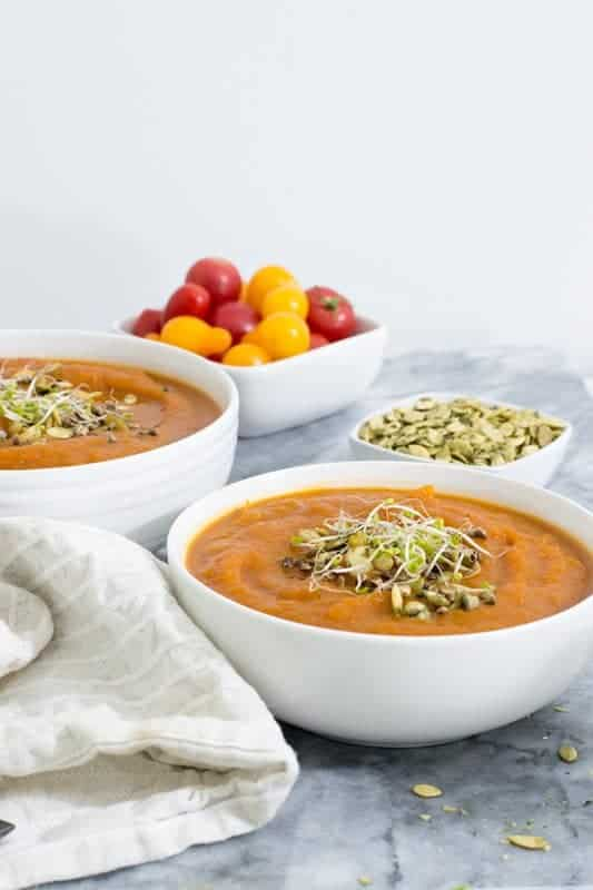This slow cooker curried butternut squash soup is the perfect meal for a busy weeknight or Sunday Supper.  #vegan #glutenfree #paleo #Whole30 | https://bitesofwellness.com