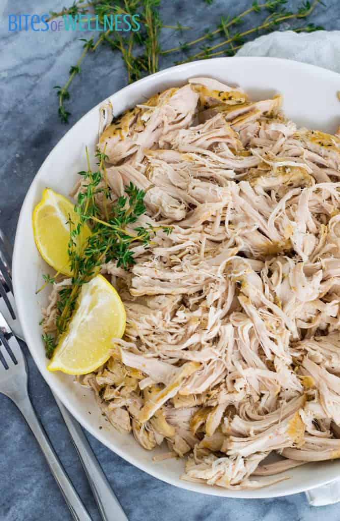 Slow cooker shredded chicken recipe on a plate with garnish