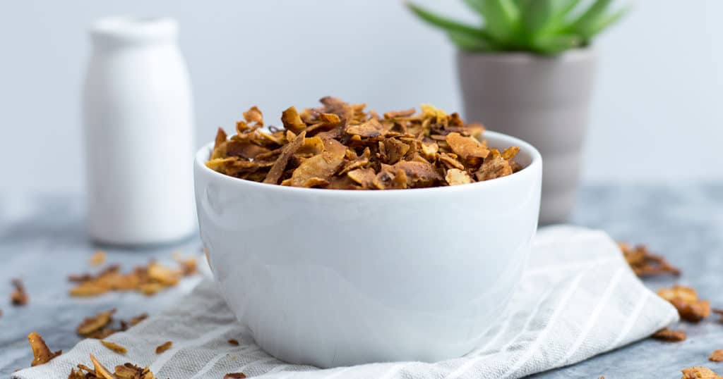 Coconut vegan bacon piled high in a bowl