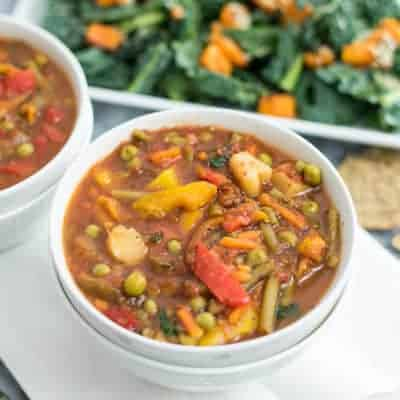 This super simple frozen vegetable soup is ready in under 30 minutes and doesn't require any chopping! This recipe is vegan, paleo, Whole30 and so easy to make! #soup #vegan #dinner #vegetablesoup | bitesofwellness.com