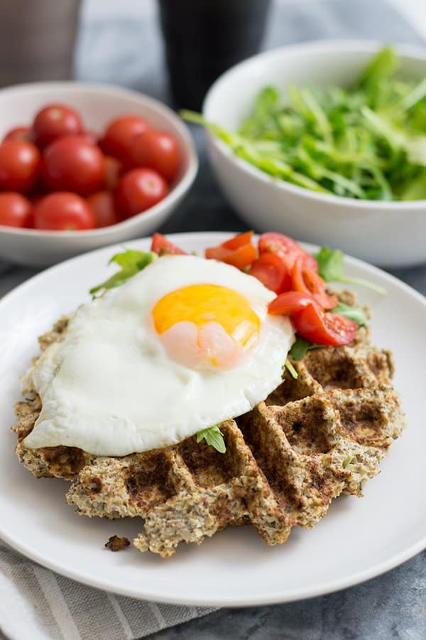Savory cauliflower waffles with an egg and veggies