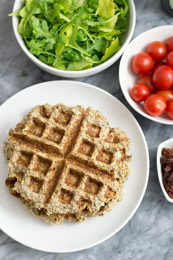 Two savory cauliflower waffles with vegetables