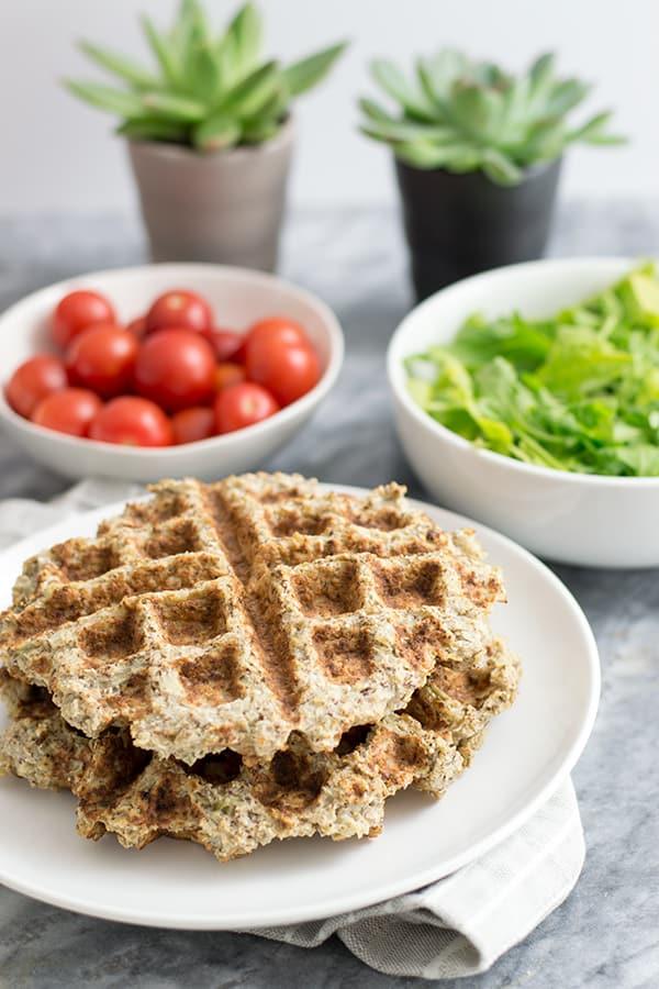 Two savory cauliflower waffles with veggies