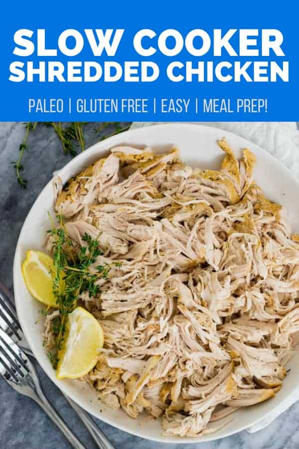 slow cooker shredded chicken on a plate with a lemon wedge