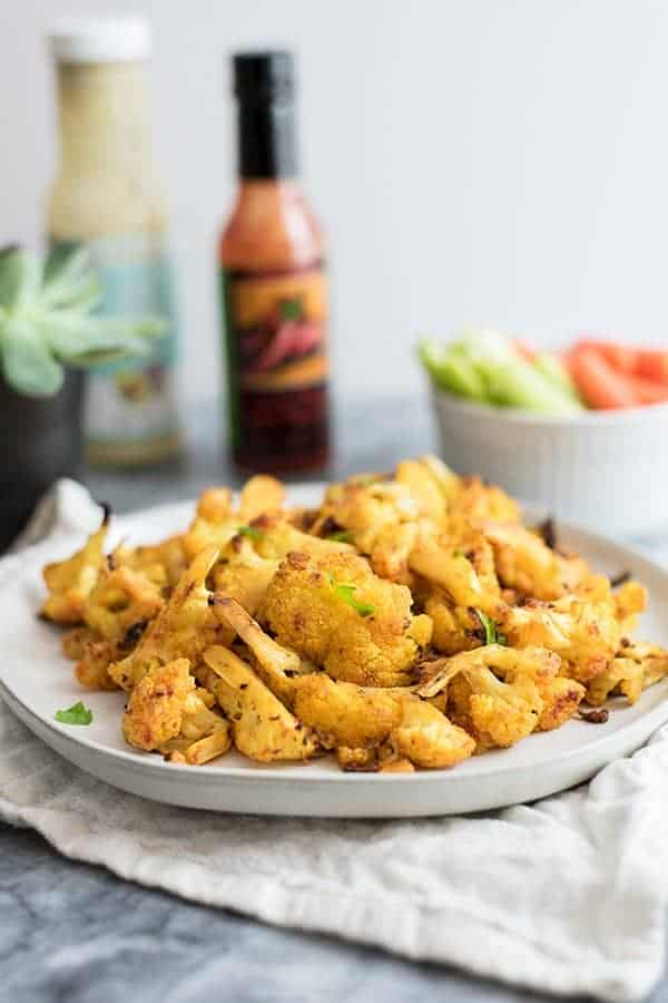 Vegan cauliflower buffalo wings with carrots and celery
