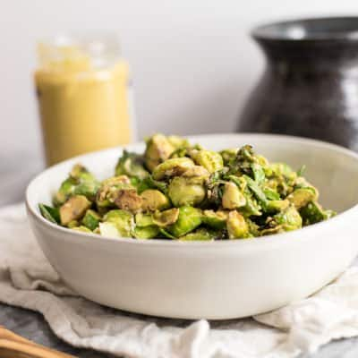 This paleo brussels sprouts with creamy dijon sauce is the perfect weeknight side dish! Whole30, vegan, dairy free, grain free and super simple to prepare! | #paleo #brusselssprouts #whole30 #vegan | bitesofwellness.com