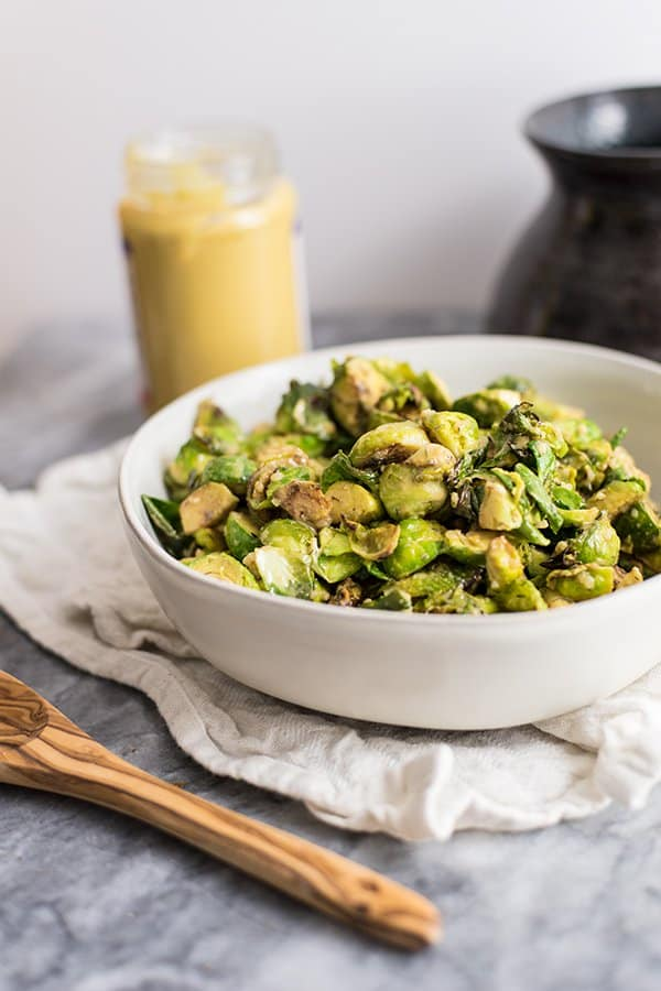 Paleo brussels sprouts with creamy dijon sauce in a bowl