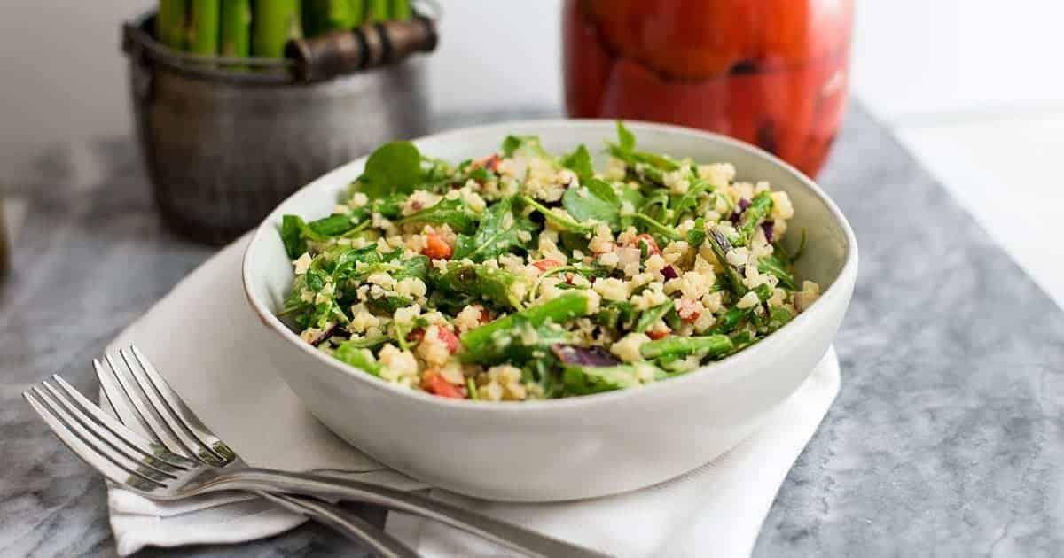 Asparagus Spring salad in a white bowl on white napkin